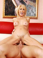 Erica Lauren is the big boob GILF enjoying a nice hardcore cam show with a much younger guy